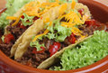 Mexican beef tacos in pottery serving dish Stock Images