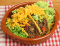 Mexican beef tacos in terracotta serving dish Royalty Free Stock Images