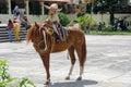 Mexican boy on  horseback Royalty Free Stock Photo