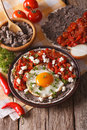 Mexican breakfast: fried egg with salsa on the plate close-up. v Royalty Free Stock Photo