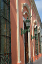Mexican building details front of buildings inhistoric merida mexico with ironwork and lamps Royalty Free Stock Photos