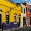 Mexican city colorful building on street Royalty Free Stock Image