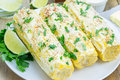 Mexican corn with butter, mayonnaise, parmesan, chili, cilantro, lime Royalty Free Stock Photo