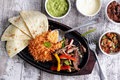 Mexican cuisine fajitas Royalty Free Stock Photo
