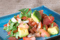Mexican cuisine pico de gallo the dish is a fresh uncooked salad made from chopped tomato onion cilantro fresh serranos salt and Royalty Free Stock Image