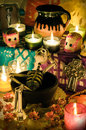Mexican day of the dead altar dia de muertos traditional with skeleton sugar skulls and candles Royalty Free Stock Photo