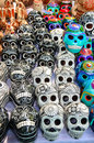 Mexican day of the dead souvenir skulls traditional ceramic at market stall Royalty Free Stock Photography