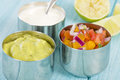 Mexican dips guacamole pico de gallo and crema Royalty Free Stock Photos
