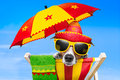 Mexican dog on vacation relaxing on a deck chair under an umbrella Stock Images