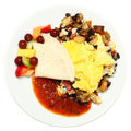 Mexican eggs with salsa potatoes fruit over white Stock Images