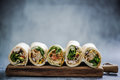 Mexican fajita wraps on serving board, copy space Royalty Free Stock Photo