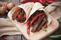 Mexican fajitas in tortilla wrap Royalty Free Stock Photo