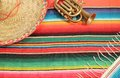 Mexican fiesta poncho rug in bright colors with sombrero traditional background copy space and trumpet Stock Images