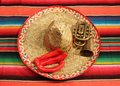 Mexican fiesta poncho rug in bright colors with sombrero traditional background copy space and trumpet Stock Photo