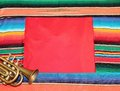 Mexican fiesta poncho rug in bright colors trumpet Stock Photo