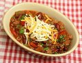 Mexican food bowl of beef chili or chilli with grated cheese Stock Photos