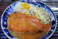 Mexican food image of a traditional dish called chile relleno with rice and beans Stock Image