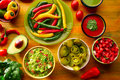 Mexican food mixed guacamole nachos chili sauce Royalty Free Stock Photo
