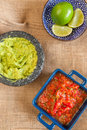 Mexican food red salsa limes and guacamole Royalty Free Stock Photography