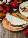 Mexican food - vegetarian quesadilla on wooden board. Royalty Free Stock Photo