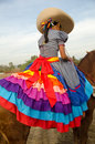 Mexican girl on horseback in traditional outfit horse riding sidesaddle Stock Photos