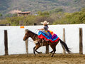 Mexican girl on horseback in traditional outfit horse riding sidesaddle Stock Images