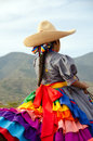 Mexican girl on horseback in traditional outfit horse riding sidesaddle Royalty Free Stock Images