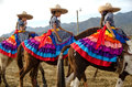 Mexican girls on horseback in traditional outfit horse riding sidesaddle Royalty Free Stock Photography