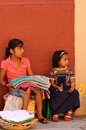 Mexican girls selling textiles Royalty Free Stock Images