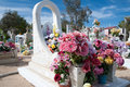 Mexican grave decorated with silk flowers in a cemetary Stock Images