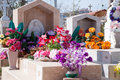 Mexican grave decorated with silk flowers in a cemetary Stock Photo