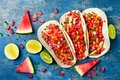Mexican grilled chicken tacos with watermelon salsa. Royalty Free Stock Photo
