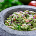 Mexican guacamole in stone molcajete Royalty Free Stock Photo