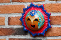 Mexican handcraft sun face made of clay a traditional happy in this regional from metepec mexico Stock Photography