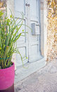 Mexican home with antique wooden mailbox wood doors old on a stone facade house Stock Photo