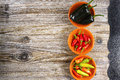 stock image of  Mexican hot chili peppers colorful mix jalapeno on orange bowls