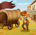 A mexican man holding a gun beside a wagon illustration of Royalty Free Stock Image