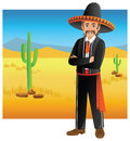 Mexican man standing with folded hands in dessert with traditional outfit Royalty Free Stock Photography