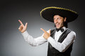 Mexican man wears sombrero isolated on the white Royalty Free Stock Photo