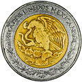 Mexican peso pesos gold and silver coin obverse with the national shield and lettering estados unidos mexicanos isolated Stock Image