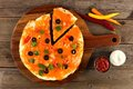 Mexican pizza with cut slice on wood server, downward view Royalty Free Stock Photo