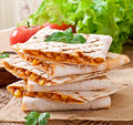 Mexican Quesadilla sliced with vegetables Royalty Free Stock Photo