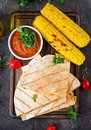 Mexican Quesadilla wrap with chicken, corn and sweet pepper and tomato sauce. Royalty Free Stock Photo