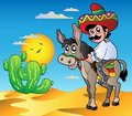 Mexican riding donkey in desert Royalty Free Stock Photo