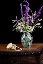 Mexican sage with silver lace flowers in a mosaic vase next to a Royalty Free Stock Photo