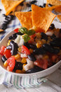 Mexican salsa with beans and corn chips nachos close up. vertica Royalty Free Stock Photo