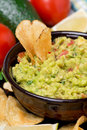 Mexican sauce guacamole and chips close up vertical Royalty Free Stock Photo