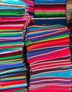 Mexican serape colorful stacked handcrafts Stock Photos