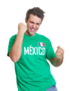 Mexican sports fan freaks out from mexico with a green jersey freaking on a white background Stock Photo