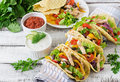 Mexican tacos with chicken, bell peppers, black beans and fresh vegetables Royalty Free Stock Photo
